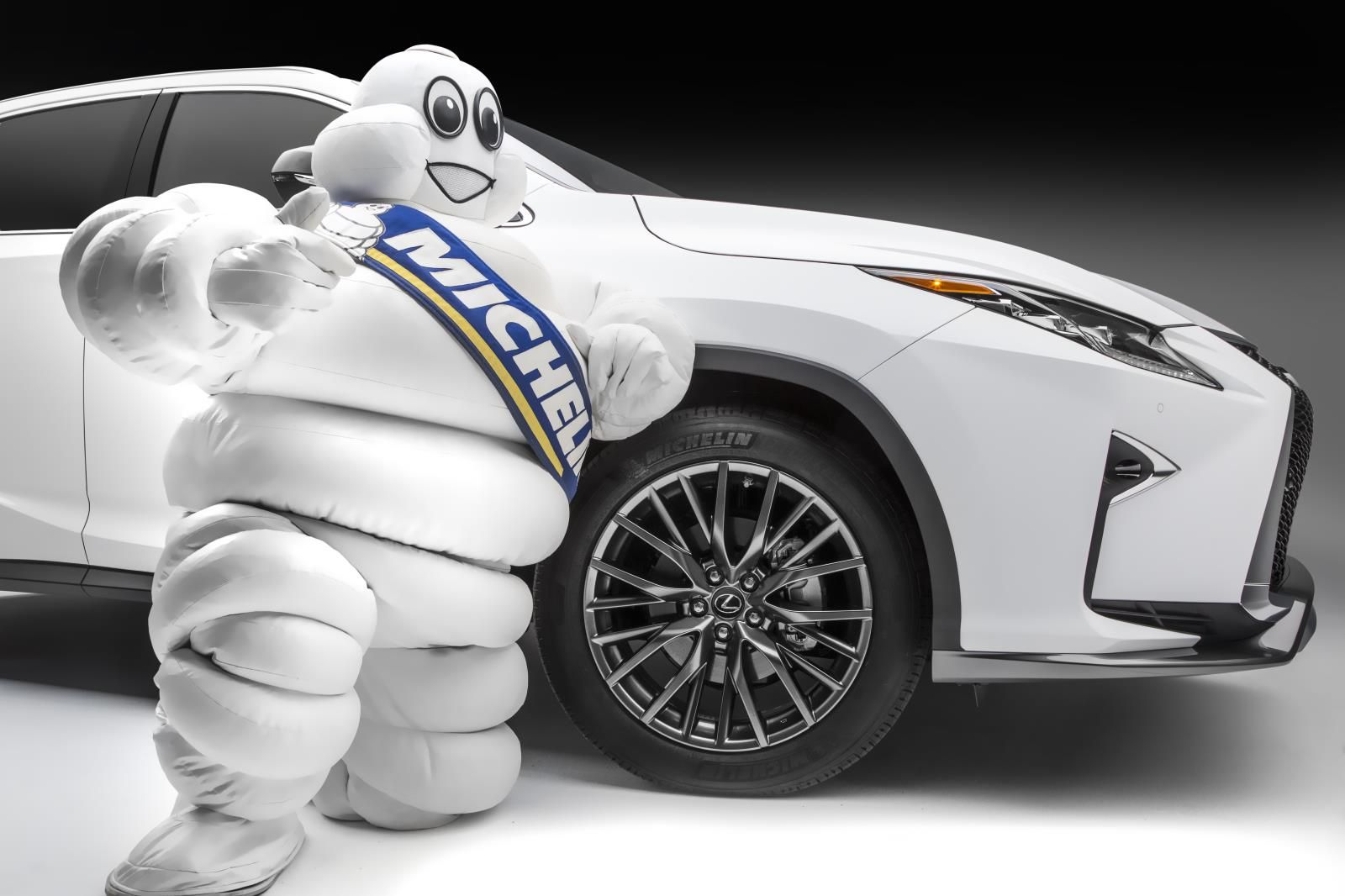 Michelin man with car tire