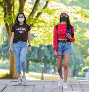 Lehigh students wearing masks while walking on campus
