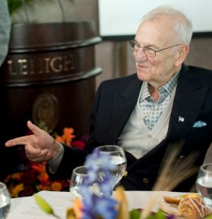Lee Iacocca '45 speaks with a participant in the Global Village.