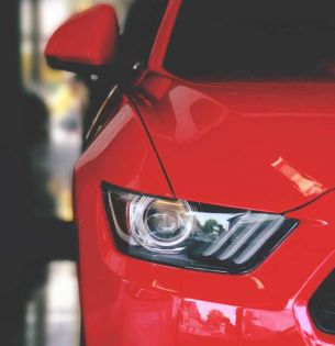 Red car photo by Avinash Patel from Pexels