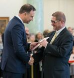 Wojciech Misiolek, right, was honored as a professor of engineering science from Polish President Andrzej Duda (left) at the President's Palace in Warsaw, Poland.