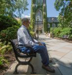 Michael Yonkovig looks towards Packard Lab while sitting outside the Alumni Memorial Building during a campus visit in August. (Photo by Christa Neu / Lehigh University)