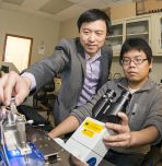 Assistant professor Frank Zhang (standing) with Ph.D. candidate Yan Xu (Photo by Ryan Hulvat / Lehigh University)